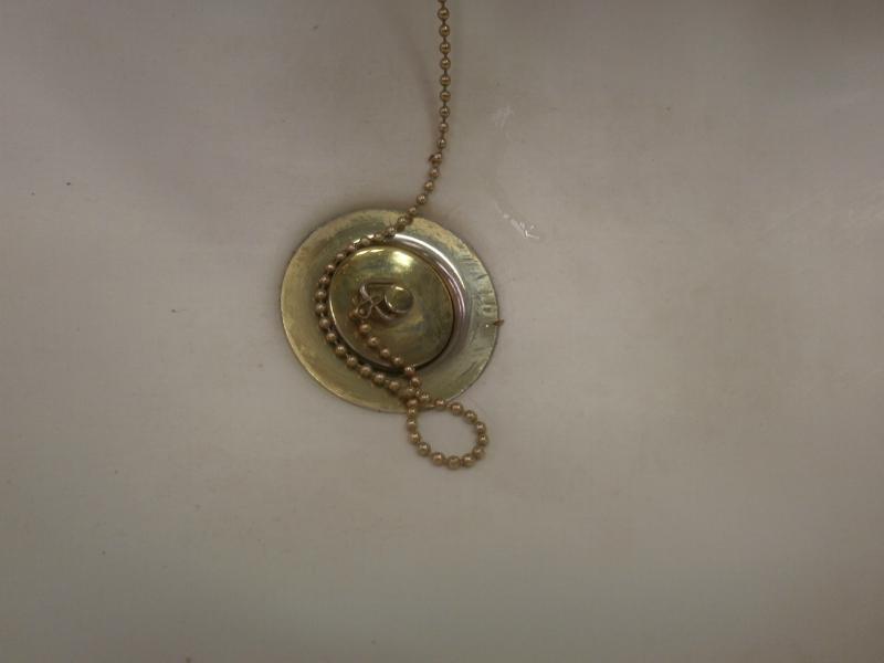 Used caravan plastic wash basin with brass pressure tap